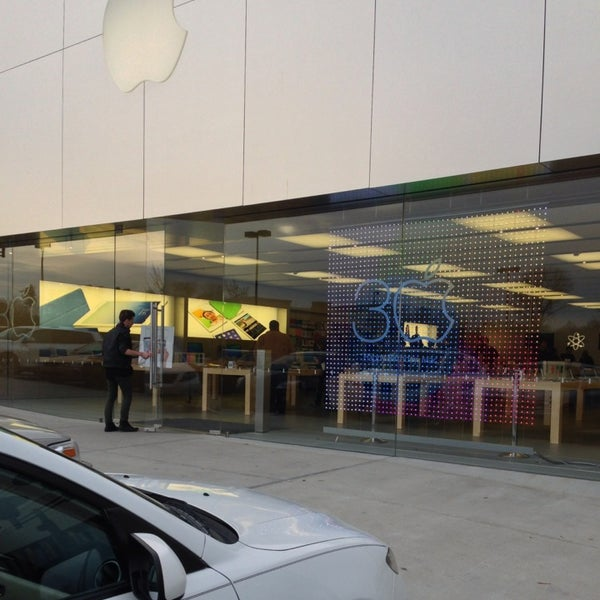 Photo taken at Apple Store, Friendly Center by Jessica A. on 2/6/2014