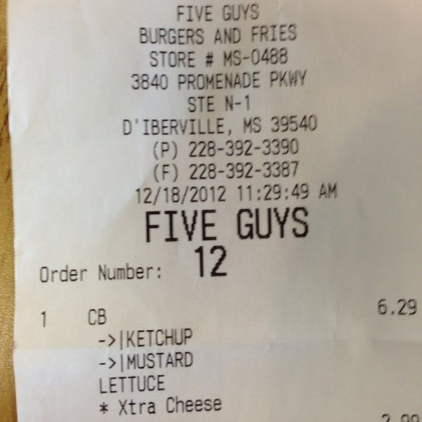 Photo taken at Five Guys by Nicholas on 12/18/2012