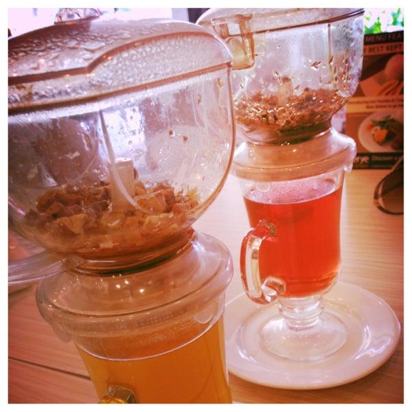 Photo taken at Sérye Café Filipino by Missy B. on 4/17/2013