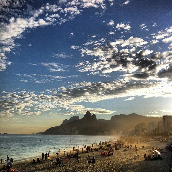 Photo taken at Praia de Ipanema by Marcelo B. on 7/13/2013