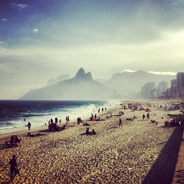 Photo taken at Praia de Ipanema by Marcelo B. on 7/19/2013