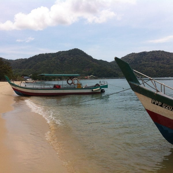 Photo taken at Teluk Bahang Beach by RiRin on 3/30/2014