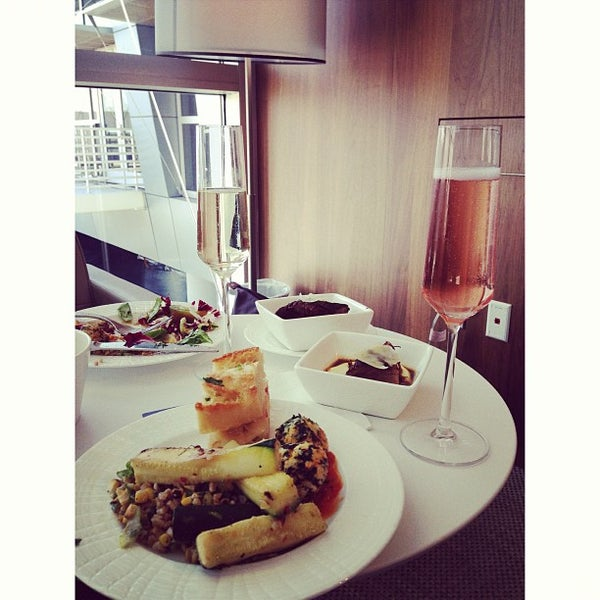 Photo taken at The Centurion Lounge by American Express by Miranee on 8/22/2013