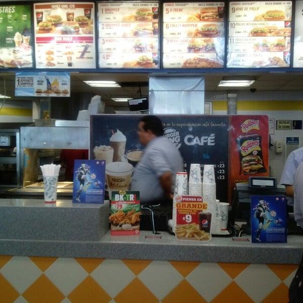 Photo taken at Burger King by Mau M. on 6/13/2014