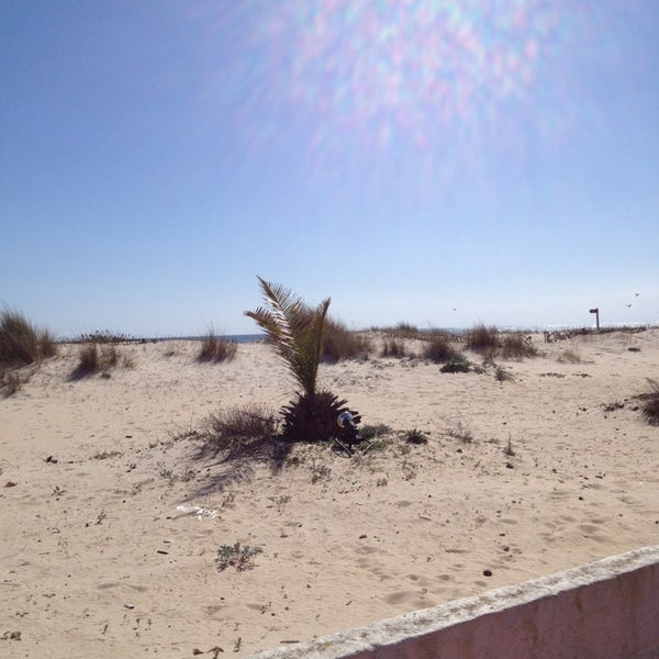 Photo taken at Praia do Barril by Angela A. on 2/27/2013