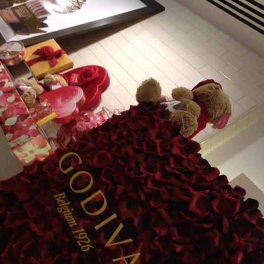 Photo taken at Godiva Chocolatier by Matthew S. on 2/3/2013