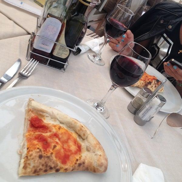 Photo taken at Canasta Pizzeria & Ristorante by Julia K. on 5/28/2014
