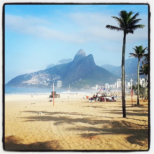 Photo taken at Praia de Ipanema by Alessandro A. on 7/22/2013