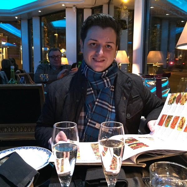 Photo taken at Asador Café Veneto by Robert A. on 12/30/2014