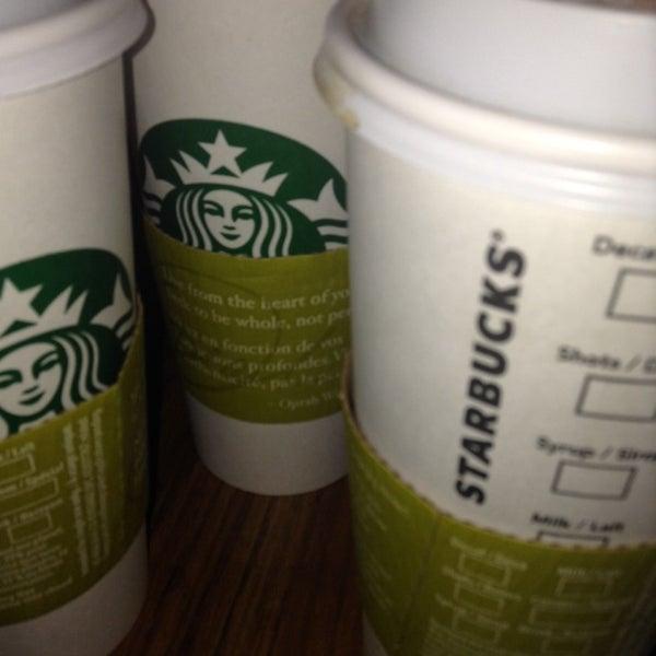Photo taken at Starbucks by iKarvine M. on 5/1/2014