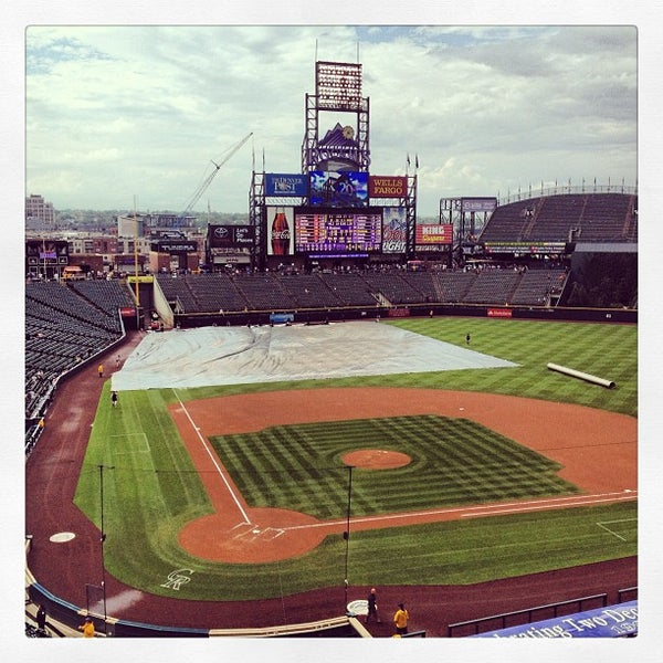 Photo taken at Coors Field by Andrea E. on 7/25/2013
