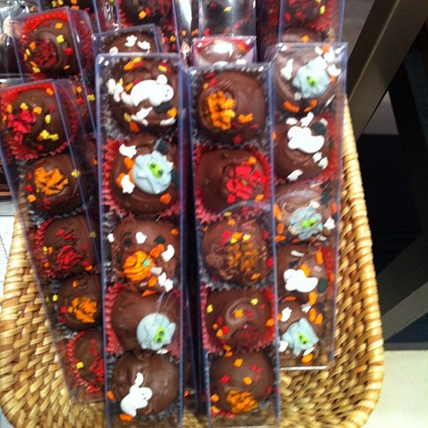 Photo taken at Godiva Chocolatier by Jennifer D. on 10/17/2012