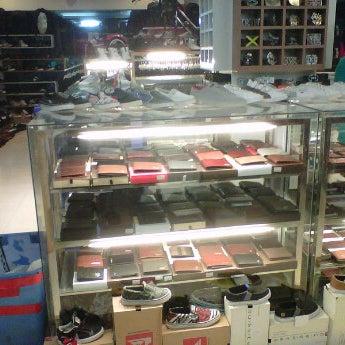 Photo taken at Outlet Biru by Leonardo P. on 12/31/2011