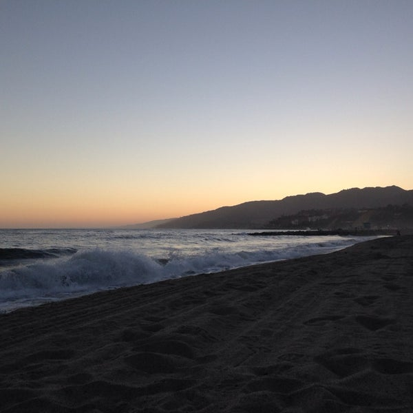 Photo taken at Pacific Palisades Beach by Aaron B. on 7/24/2014