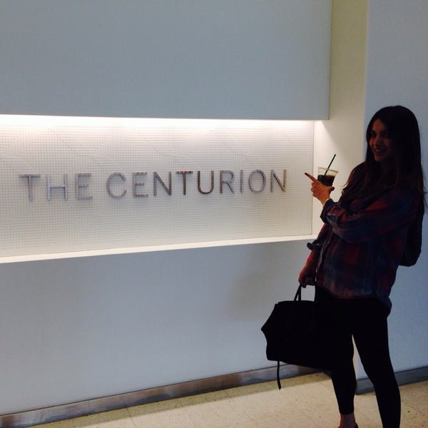 Photo taken at The Centurion Lounge by American Express by Emily E. on 10/31/2013