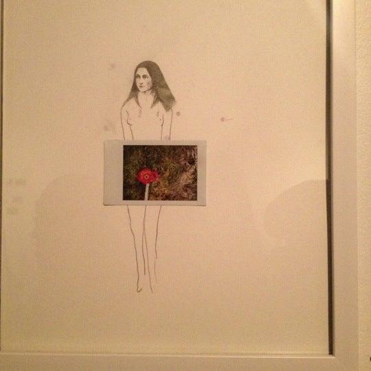 Photo taken at Vermillion Gallery & Wine Bar by Michelle K. on 11/26/2012