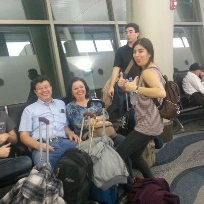 Photo taken at Gate 5 Aeropuerto Internacional Juan Santamaria by Silvia S. on 12/17/2012