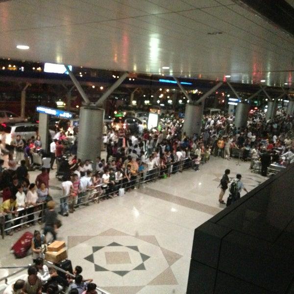 Photo taken at Tan Son Nhat International Airport (SGN) Sân Bay Quốc Tế Tân Sơn Nhất by Anh T. on 3/1/2013
