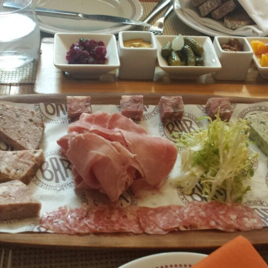 Photo taken at Bar Boulud by Carissa S. on 7/23/2013