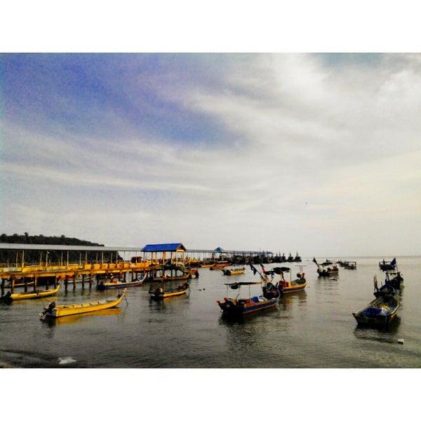 Photo taken at Teluk Bahang Beach by Nur Natashadila M. on 4/16/2015