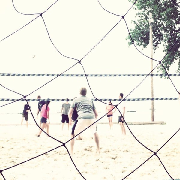 Photo taken at Whiskey Island Volleyball Courts by Luis C. on 7/16/2015
