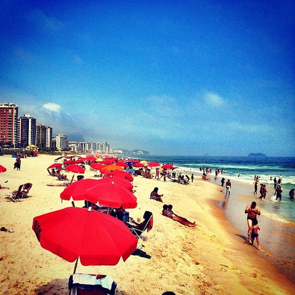 Photo taken at Praia da Barra da Tijuca by Patrick v. on 12/27/2012