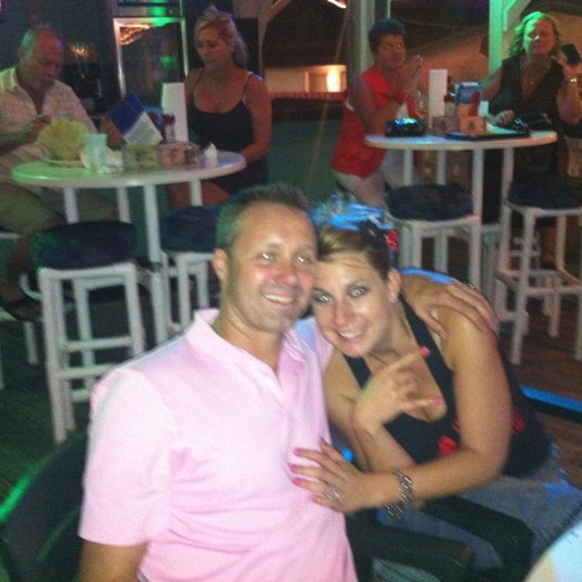 Photo taken at The Surf Restaurant & Bar by JoDee P. on 8/26/2012