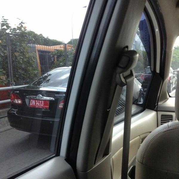 Photo taken at Perempatan Kuningan (Traffic Light) by Rusdy M. on 6/5/2013