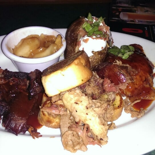 Photo taken at Smokey Bones Bar & Fire Grill by James D. on 4/27/2014