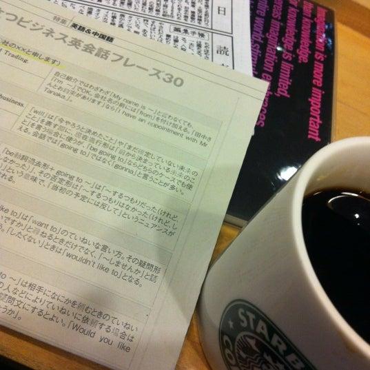 Photo taken at Starbucks Coffee 神楽坂下店 by Chieko K. on 12/14/2012