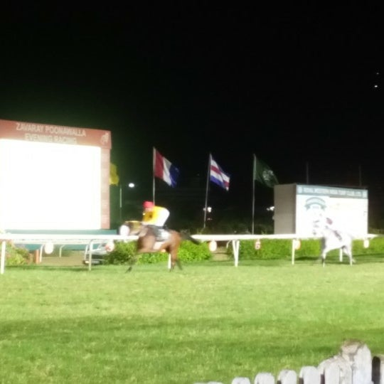 Photo taken at Mahalaxmi Race Course (Royal Western India Turf Club) by GB L. on 4/23/2016