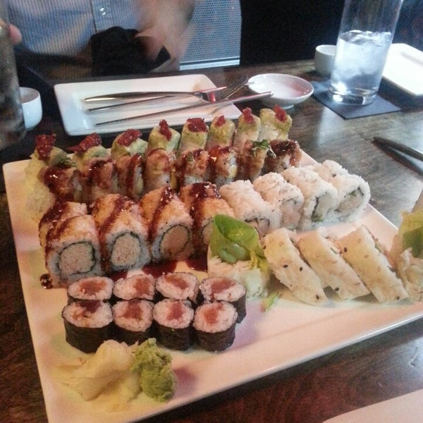 Photo taken at Blue Sushi Sake Grill by Katie T. on 4/18/2013