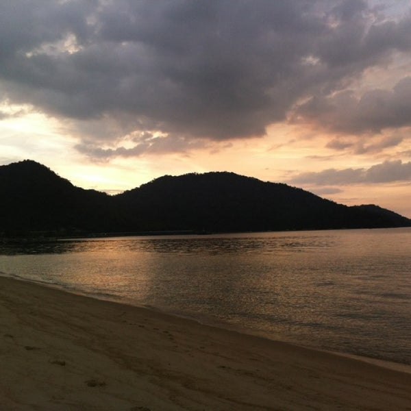 Photo taken at Teluk Bahang Beach by Danny O. on 3/1/2013