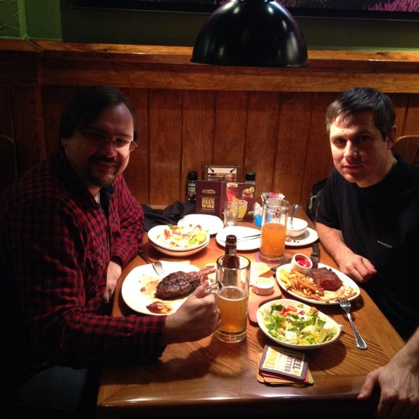 Photo taken at Outback Steakhouse by Serhiy K. on 2/9/2014