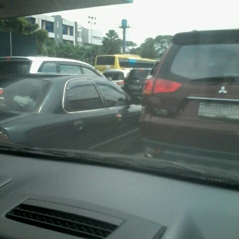 Photo taken at Gerbang Tol Cililitan by Ardy T. on 4/10/2014