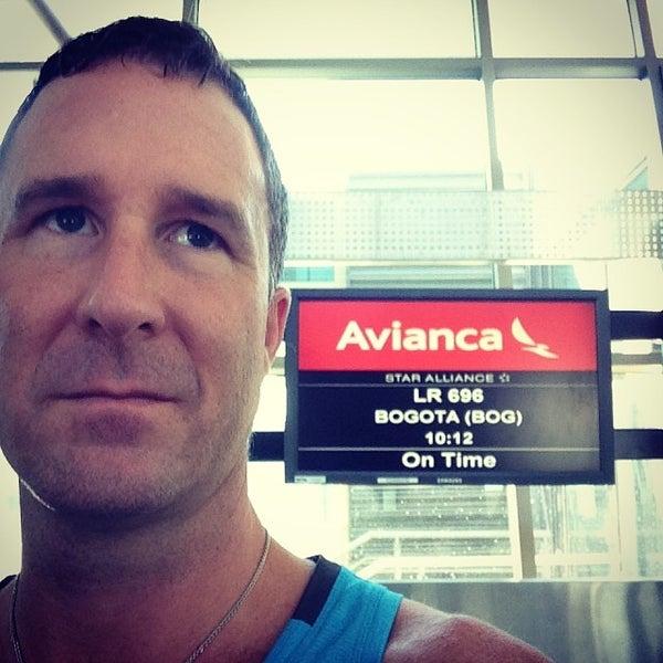 Photo taken at Gate 5 Aeropuerto Internacional Juan Santamaria by Yogi A. on 11/21/2013