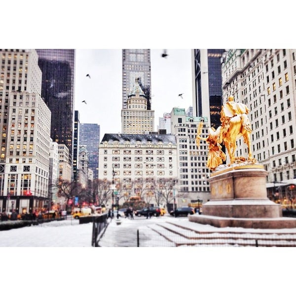 Photo taken at Grand Army Plaza by Bergdorf Goodman on 12/17/2013