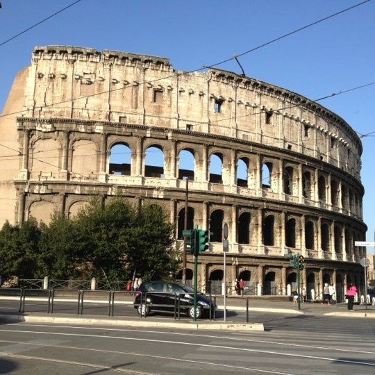 Photo taken at Piazza del Colosseo by Jerald G. on 10/21/2012