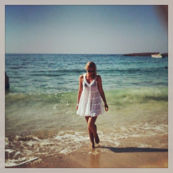 Photo taken at Makronissos beach by Nadya S. on 6/12/2013