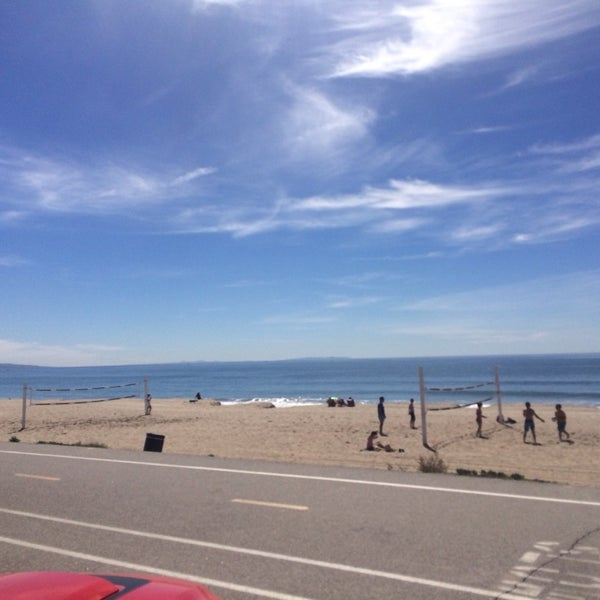 Photo taken at Pacific Palisades Beach by Sam A. on 3/9/2014