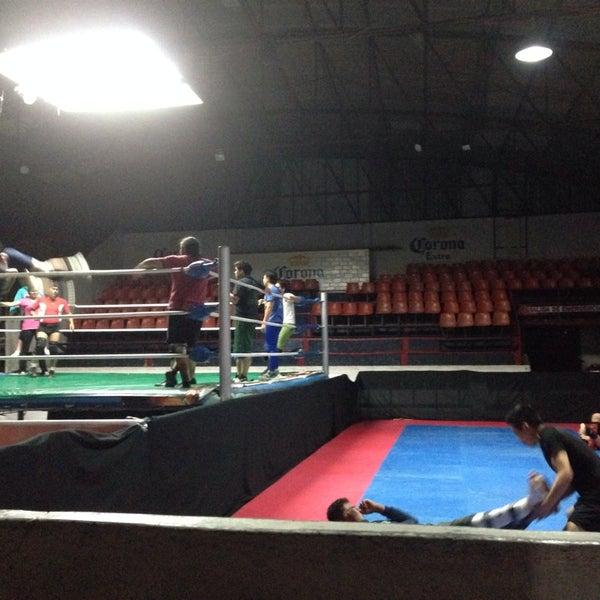 Photo taken at Arena Adolfo Lopez Mateos by Kitty S. on 8/29/2014