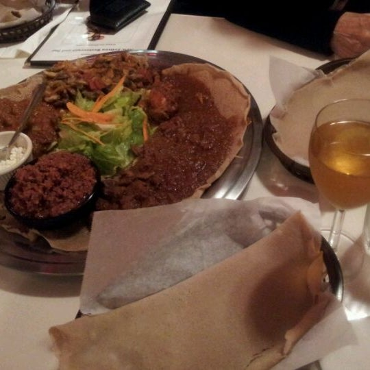 Photo taken at New Eritrea Restaurant & Bar by ngoco d. on 10/25/2011