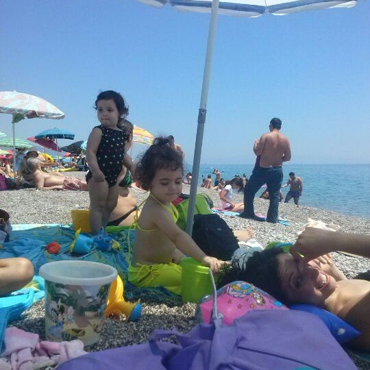 Photo taken at Spiaggia Di Fondachello by Angelo T. on 6/29/2014