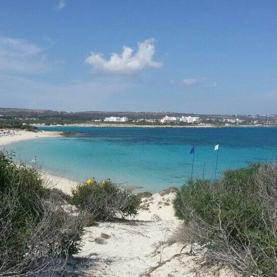 Photo taken at Makronissos beach by Alex L. on 5/20/2015
