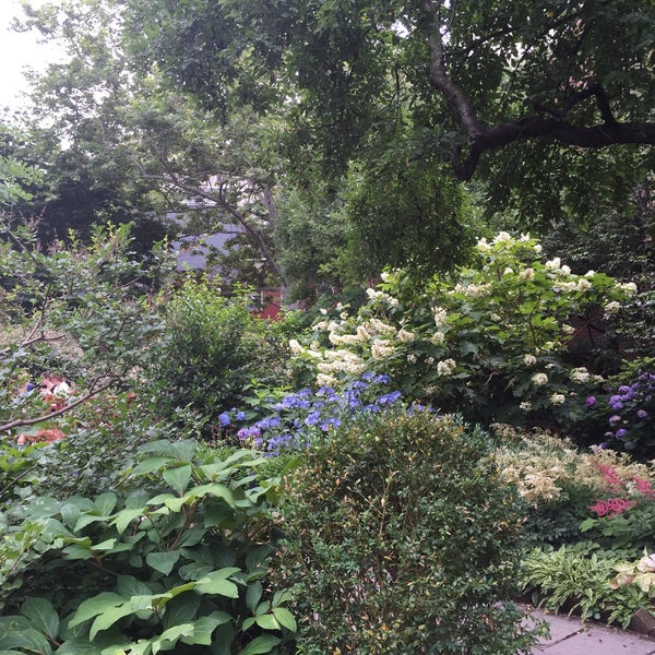 Photo taken at The Garden at St. Luke in the Fields by Jeeleighanne D. on 6/25/2015