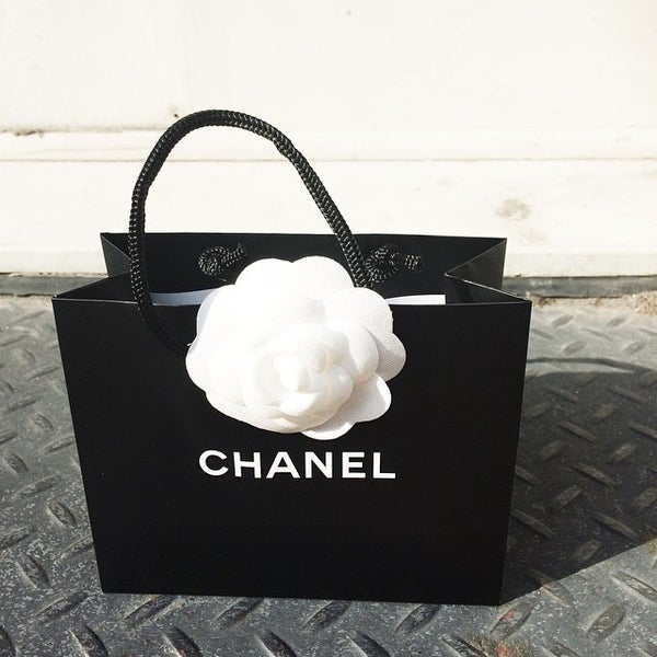 Photo taken at CHANEL Boutique by Mia J. on 6/15/2015