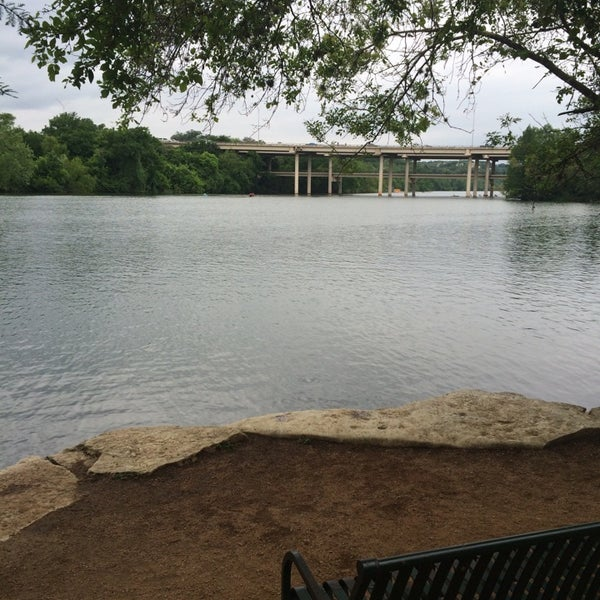 Photo taken at Lady Bird Lake Trail by Wendy C. on 4/20/2014