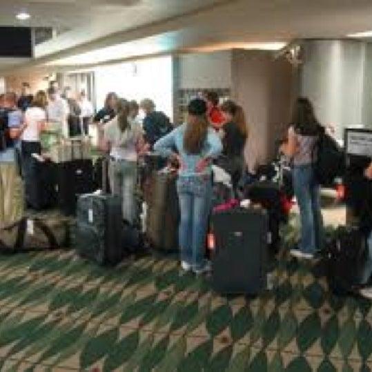 Photo taken at Gate 5 Aeropuerto Internacional Juan Santamaria by Claudio Q. on 5/6/2012