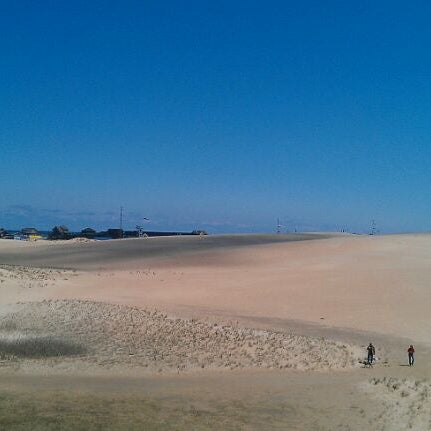 Photo taken at Jockey's Ridge State Park by Sam W. on 4/12/2012