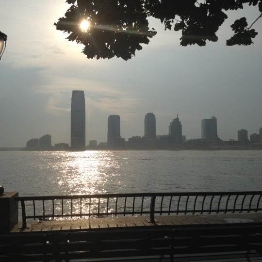 Photo taken at Battery Park City Esplanade by Rehema T. on 7/23/2012